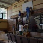 John Hankins, (at right on ladder) pastor of Sanctuary Ministries, works in the former Lincoln Elementary School on Wednesday, June 25, 2014. Volunteers have been helping to renovate the 1910 school into a place of worship, where an open house is set for Saturday, June 28. (photo/Cindy Hadish)