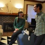 Liz Martin and Nathan Biehl discuss their house in the living room of the house that was refurbished as part of an Affordable Housing Network program in Cedar Rapids. (photo/Cindy Hadish)
